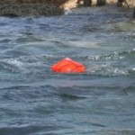life raft before inflation floating on water