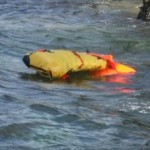 life raft inflating in the water