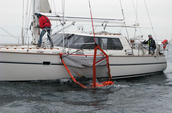 crew onboard commences hoisting man overboard
