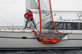 Sea Scoopa retains victim safely in net while being lifted back aboard