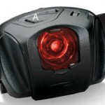 LED headlamp with snap-in color filters for night use, showing location of power switch 'A'