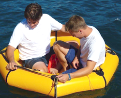 two people in revere coastal life raft