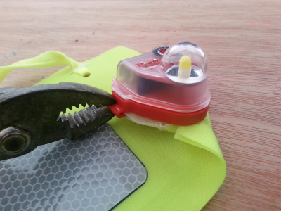 use pliers to remove strobe from danbuoy
