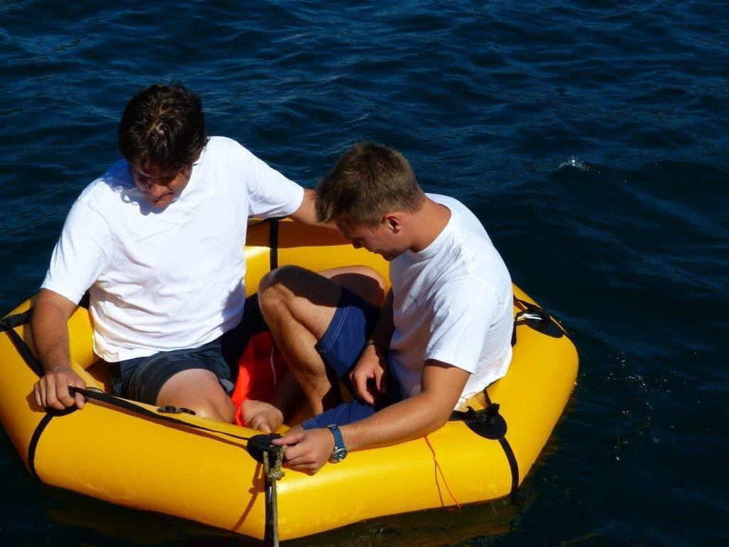 two people in coastal life raft