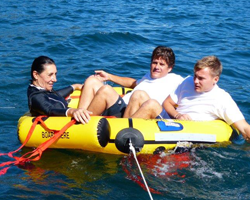 3 people in coastal life raft